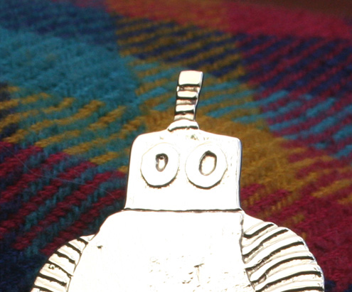 Robots and alien brooches