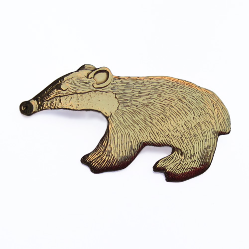 badger brooch brass