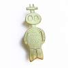 Small alien brooch